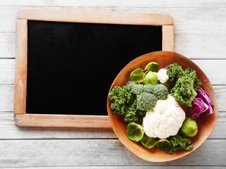 Fresh Salad Ingredients on Small Chalkboard Corner