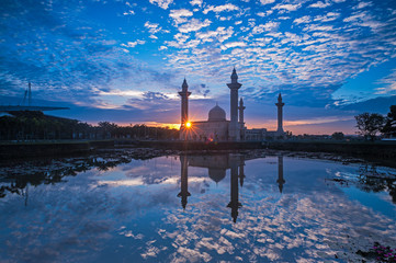 Relfection of a Mosque and Clouds at sunrise