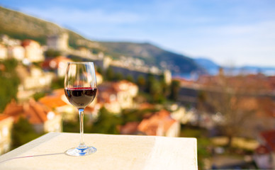Glass of red wine with city view of Dubrovnik. Croatia.