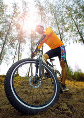 young man riding mountain bike mtb on dirt dune use for men leis