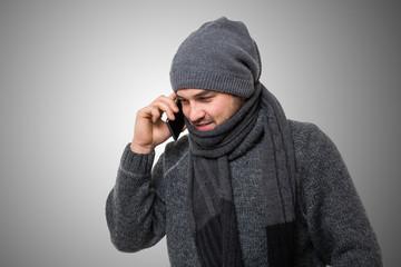 Man in winterwear talking on the phone