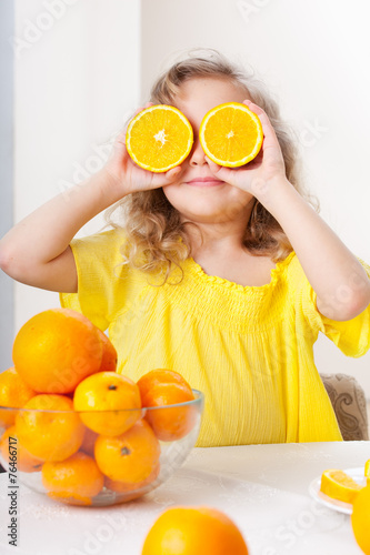 canvas print picture Child with oranges