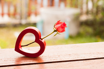 Red hearts and a roses on wooden , Valentines Day background.