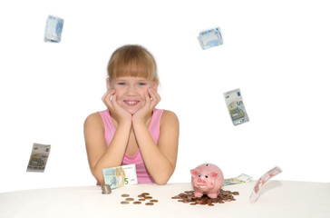 Smiling girl with flying money and piggy bank