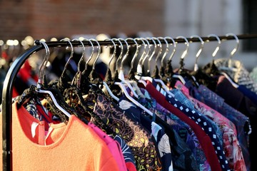 Many vintage style clothes  for sale at flea market