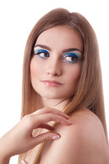 Face of a beautiful young woman with bright blue eyes