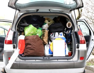 trunk full of luggage during holiday travel