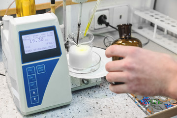Laborant makes test in laboratory