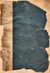piece of ancient paper background with torn edges