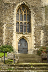 bench and entrance of All Saints Parish, Hastings