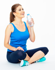yoga pose . woman holding bottle of water .