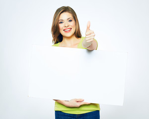 portrait of smiling woman holding white blank sign board.