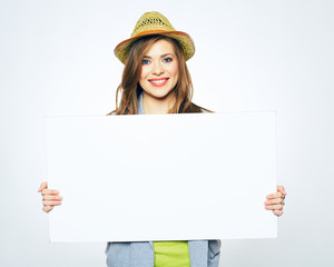 smiling hipster girl with hat holding white blank business card
