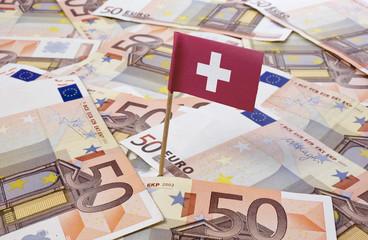 Flag of Switzerland sticking in 50 Euro banknotes.(series)