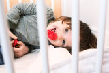 2 years boy with dummy in white bed