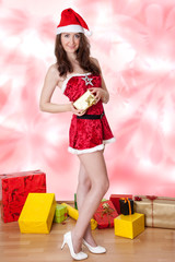Woman with Santa hat and Christmas packages