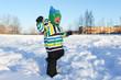 smiling happy toddler walking in winter