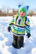 lovely little child walking in winter outdoors