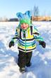 happy toddler walking in winter