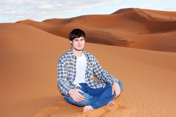 Man alone in the desert on the sand dune