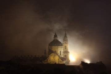 Night fog over Saint Nicholas Church in Prague, Czech Republic.