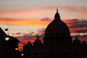 Sunset over the dome of Saint Peter's Basilica in Vatican City i