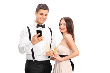 Man showing something on his cell phone to a woman
