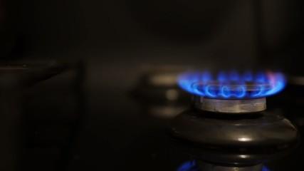 Burning flame on gas stove.