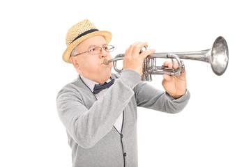 Senior gentleman playing a trumpet