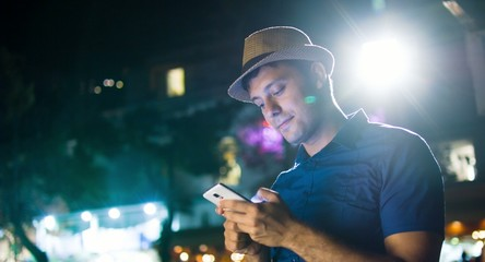 Handsome Man Typing Smartphone Urban Downtown Night Lights