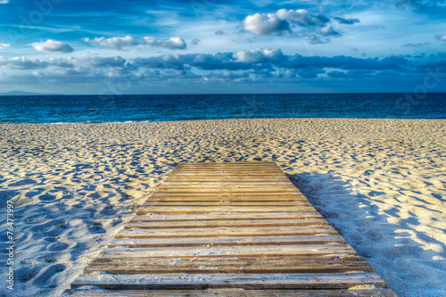 wooden boardwalk on the sand in hdr