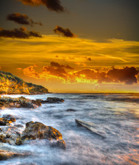 rocky coast under a scenic sky at sunset
