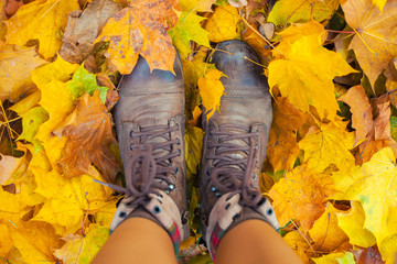 boots on the autumn leaves