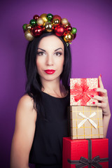 beautiful woman wearing a wreath made from Christmas decorations