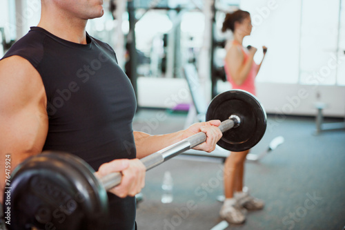 Gym: Anonymous Man Working Out With Barbell - 76475924