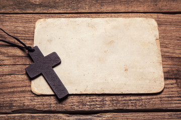 wooden cross on paper background
