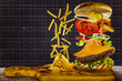 Delicious cheeseburger with flying ingredients