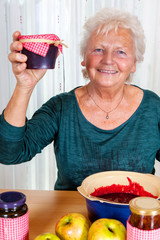 Granny proudly displays her homemade jam