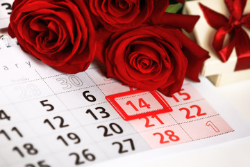 red roses lay on the calendar with the date