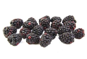 Bunch of blackberries on white background.