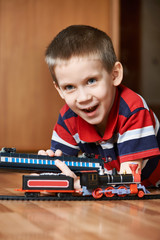 Happy boy playing with railway