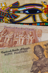 Typical Egyptian papyrus and different banknotes