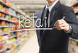 Leinwanddruck Bild - Business man writing word retail in the supermarket