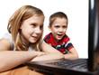 Children looking to laptop