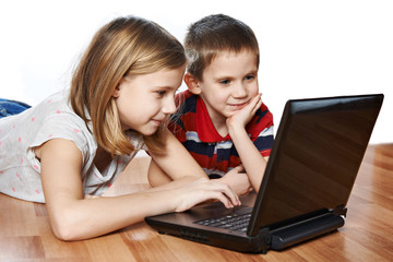 Sister and brother with laptop