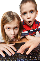 Children surprise and emotional look at laptop screen