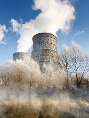 Day view of power plant, smoke from the chimney