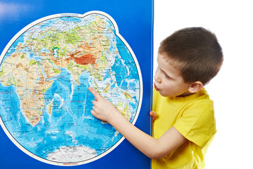 Little boy points to place on world map