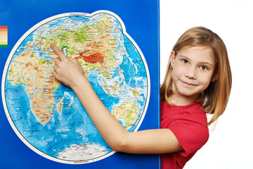 Happy girl points to place on world map