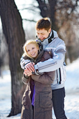 loving couple in the winter man hugging woman